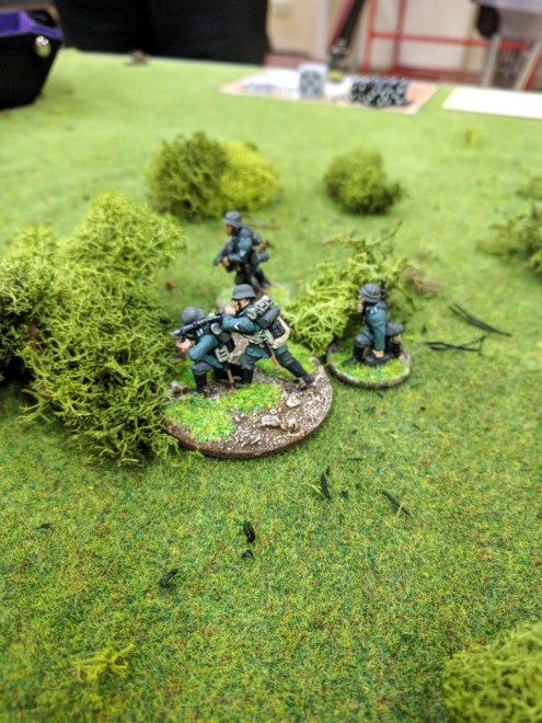 The small German team deploys into the scrub...