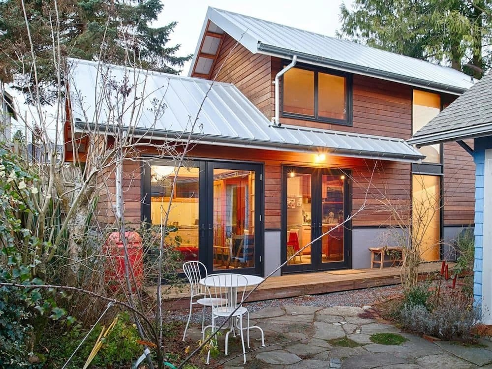 salvaged style 550sf backyard cottage built with blue jeans bowling alley scraps
