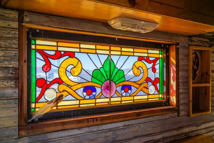 Reclaimed stained glass window in John's House Truck