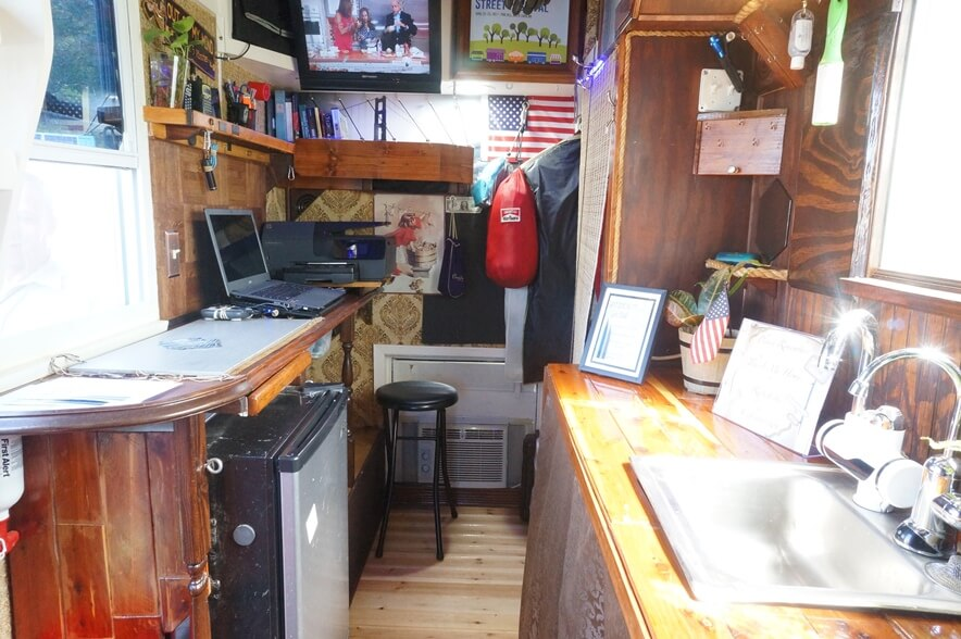 Kitchen with refrigerator and desk.