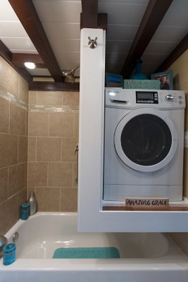 nixie tiny house has floating washer/dryer in bathroom!