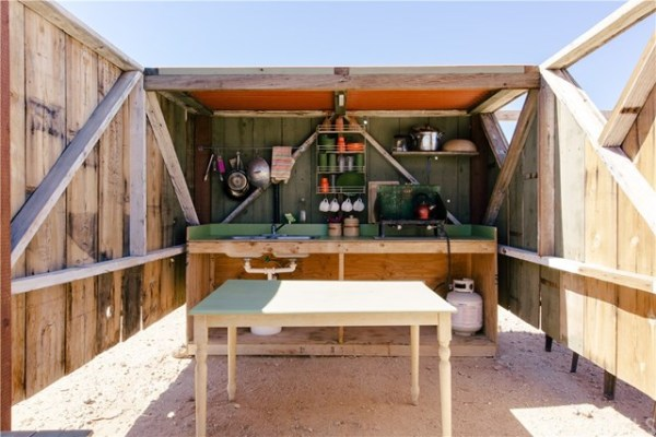 Off-Grid Tiny Cabin with Outdoor Kitchen and Outhouse 004