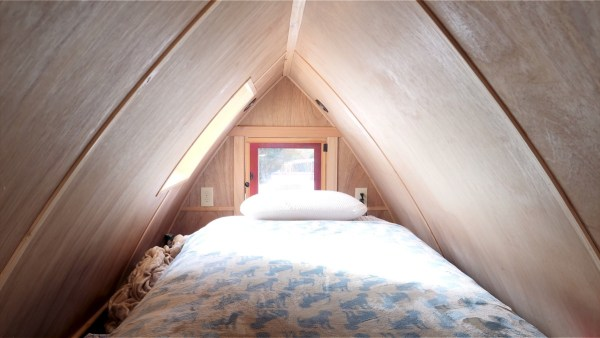 Gothic Arch Sleeping Loft in this Magical Tiny House by Zyl Vardos