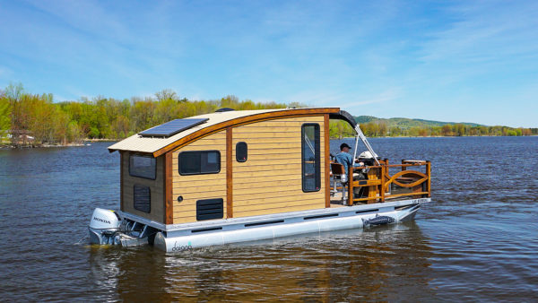 Woodworker Designs and Builds the Perfect Tiny House Boat called the Le Koroc