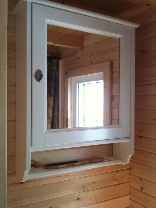 Bathroom Storage and Mirror Inside Tiny Home on Wheels