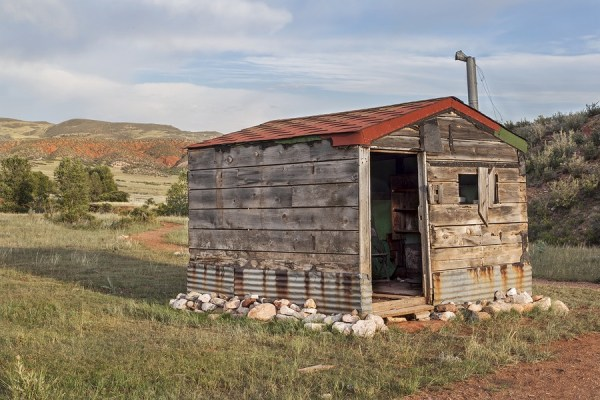 bigstock-old-cabin-in-Rocky-Mountains--49616006
