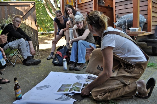 Dee Williams with group teaching them tiny house construction methods