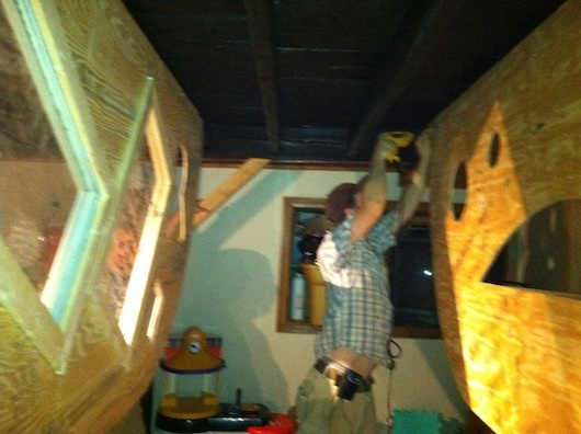 Deek installing the Krunk Bunk micro cabin to the ceiling
