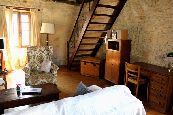Family Uses 17th Century Tiny Stone Cottage In France For