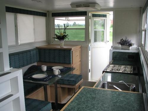 pipercraft-trailerable-houseboat-kitchen-and-dining