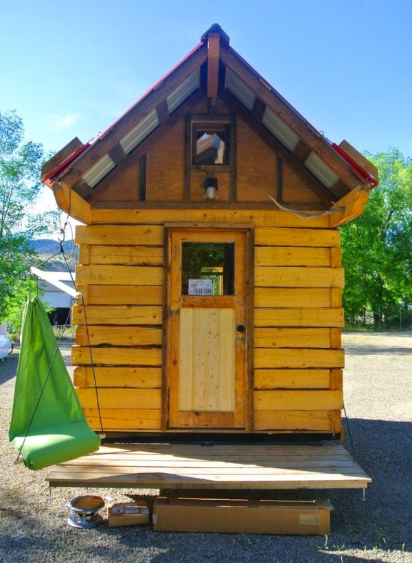 stanley-rocky-mountain-tiny-houses-log-cabin-on-wheels-flipping-overhangs-greg-parham-0001