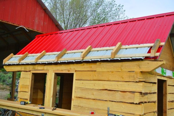 stanley-rocky-mountain-tiny-houses-log-cabin-on-wheels-flipping-overhangs-greg-parham-0007
