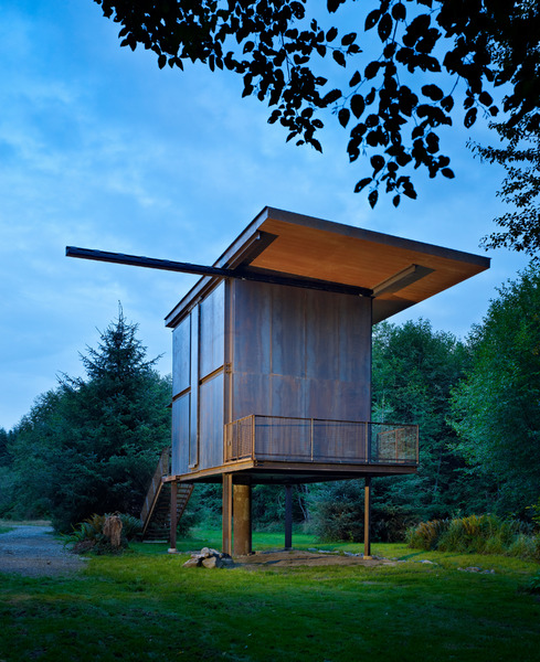steel-clad-tiny-modern-cabin-with-shutters-on-stilts-02