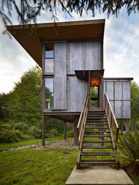 steel-clad-tiny-modern-cabin-with-shutters-on-stilts-04