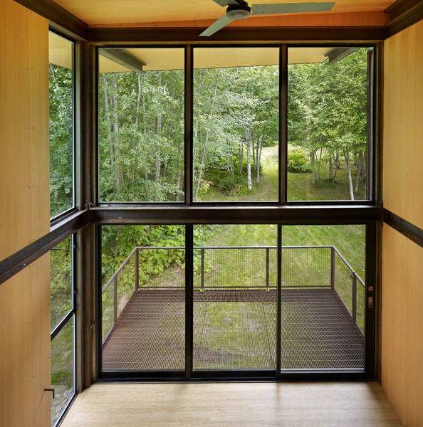 steel-clad-tiny-modern-cabin-with-shutters-on-stilts-06