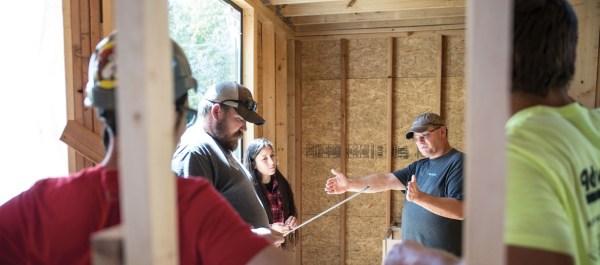 UTA professor teaching students about building