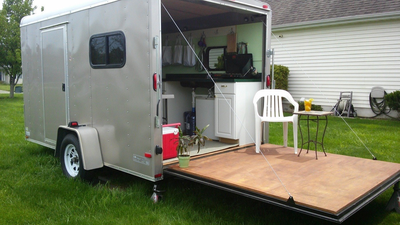 Woman Converts Cargo Trailer Into Stealthy And Cozy Off Grid Rv
