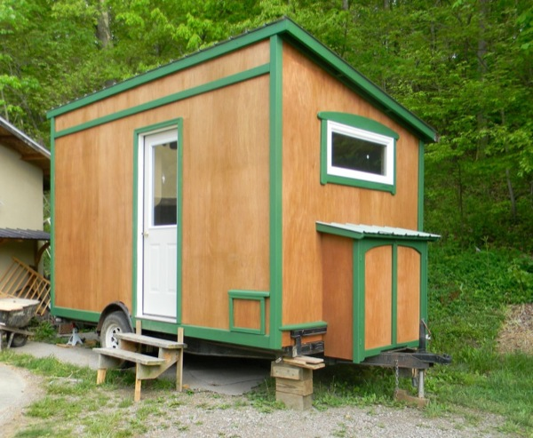 yahini-homes-104-square-feet-tiny-house-on-wheels-with-folding-porch-roof-06