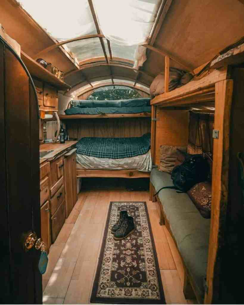 van with 4 bunk beds and a kitchen
