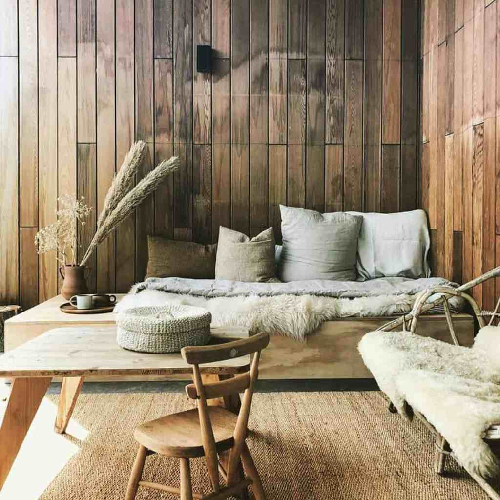 tiny house with natural wood walls and furniture