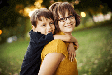 Image of a Mom with her boy on back