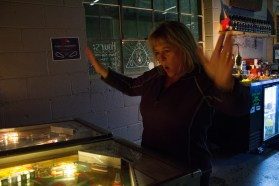 Englewood, Colo. – April 22, 2017 – Joan Heller raises her arms in triumph after easily besting the high score on a classic pinball machine at Devil's Head Distillery. Heller attributes her pinball prowess to a rare combination of lightning reflexes and women's intuition. (Derek Gregory)