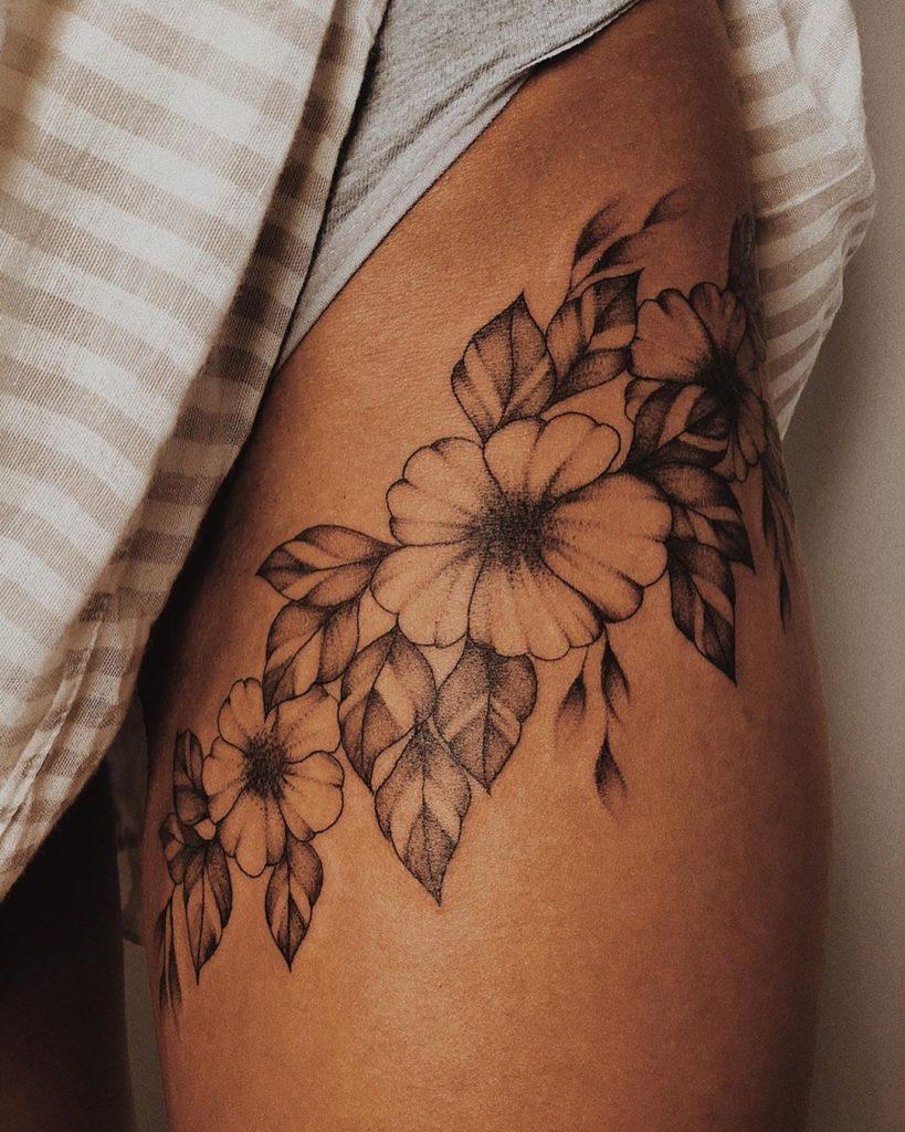 flora thigh tattoo