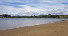 Whananaki with the footbridge ion the distance