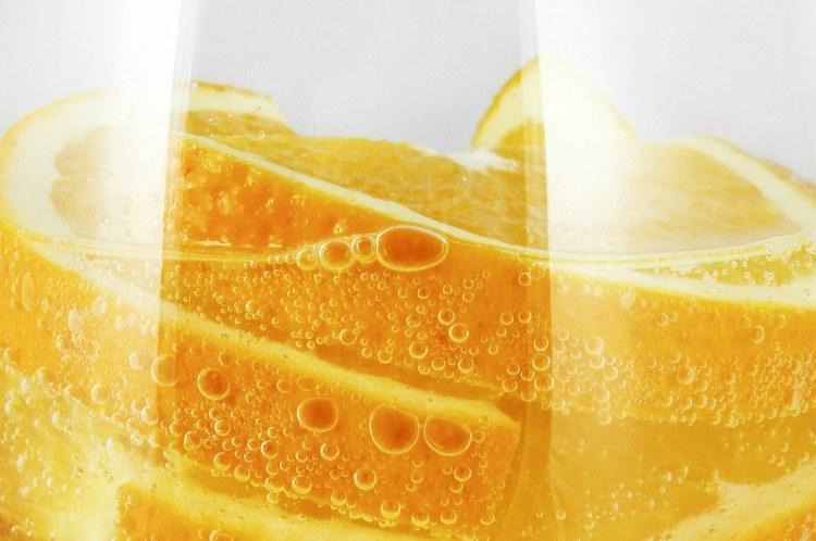 Image of orange slices in water.
