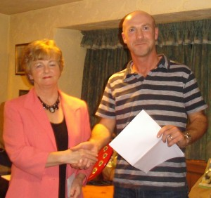 Kay Troy receives her award for best front garden from Cloughjordan Tidy Towns chairperson Niall Healy