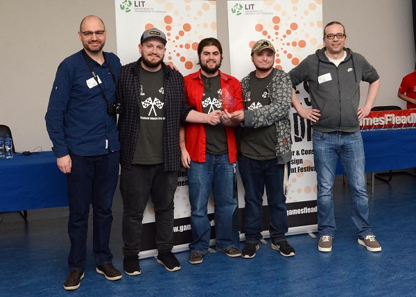 "Third Year LIT Game Development students win Best in Team Performance with their game ""Light Wave"" at Games Fleadh 2017. They are presented with their trophy by Stephanus Meiring and Ingo Schumacher from EA Galway. Photographed Left to Right: Stephanus Meiring EA, Christopher Law (Ontario, Canada), Noah Petrides (Ontario, Canada), Settimio Falsetto (Canada), and Ingo Shcumacher EA."