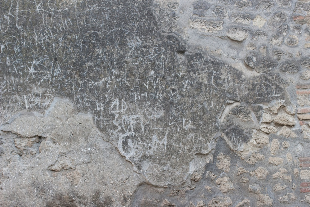More graffiti scrawled into the walls around Pompeii.