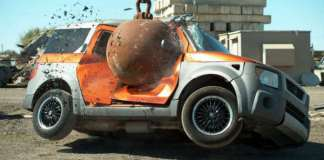 Slow-Motion 4-Ton Wrecking Ball Destroying Cars 1