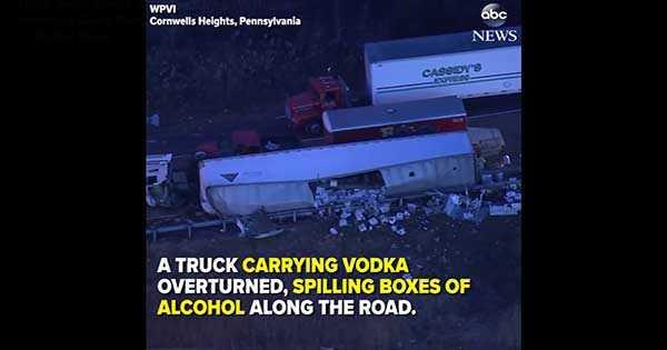 overturned truck spill vodka accident damage 1