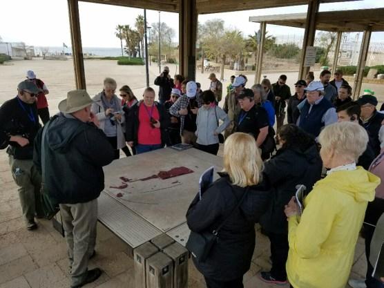 "Tour guide ""Uncle"" Kenny shows us a model of ancient Caesarea"