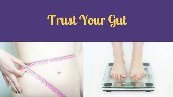 Trust Your Gut Midsection of a body with a measuring tape around the waist, feet standing on a bathroom scale
