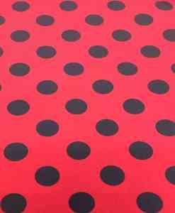 Tissu burlington gros pois noir sur fond fuchsia