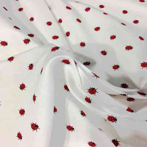 Tissu coton coccinelles