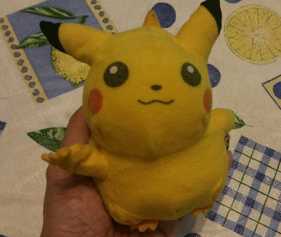 Pikachu (the reverse side of the Pokeball)