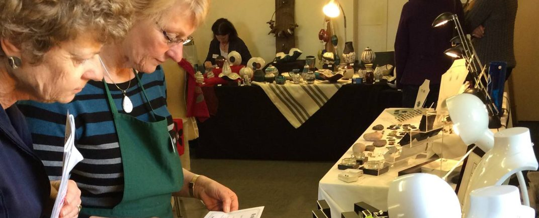 Visitors to the 2015 Craft Show deciding what to buy.