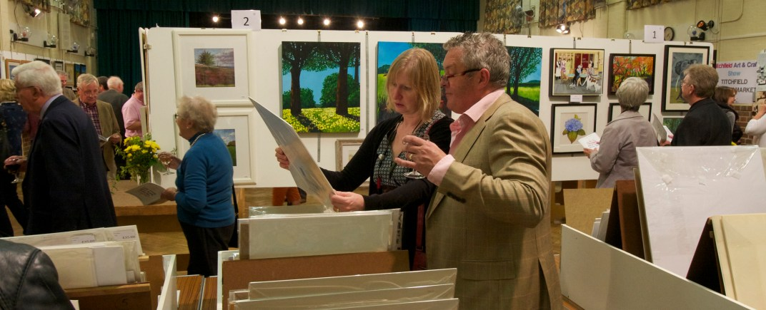 Visitors to the 2015 Art and Craft Show browse the portfolios.