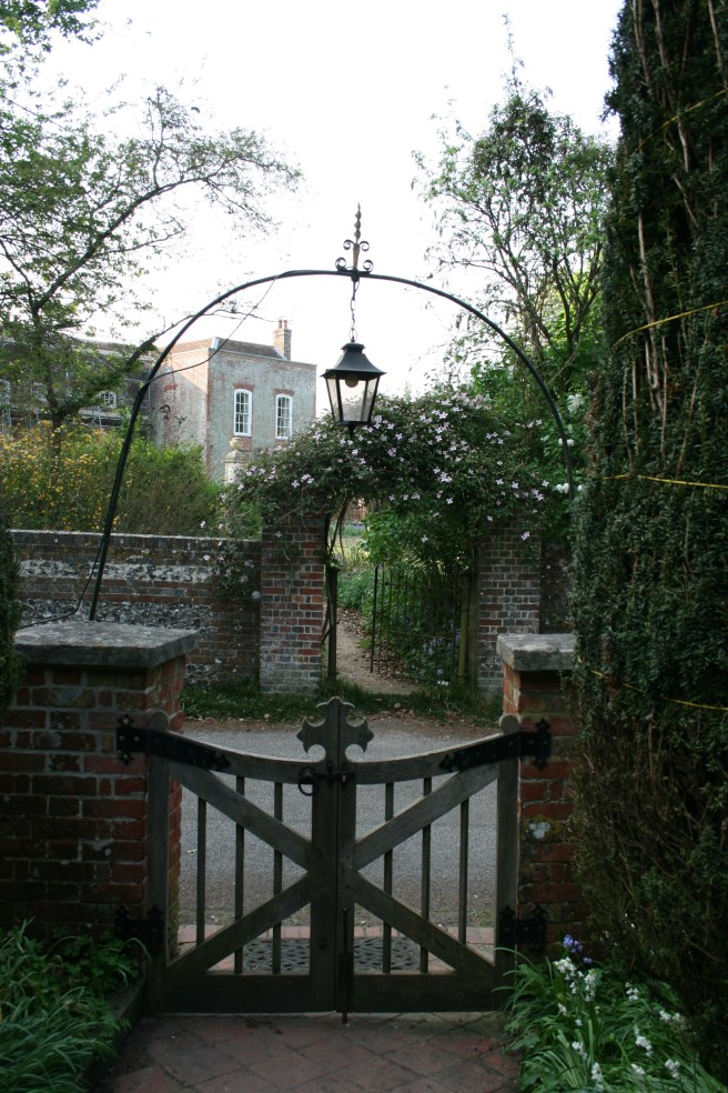 Gate from the Parish church Kilmeston with Manor house opposite