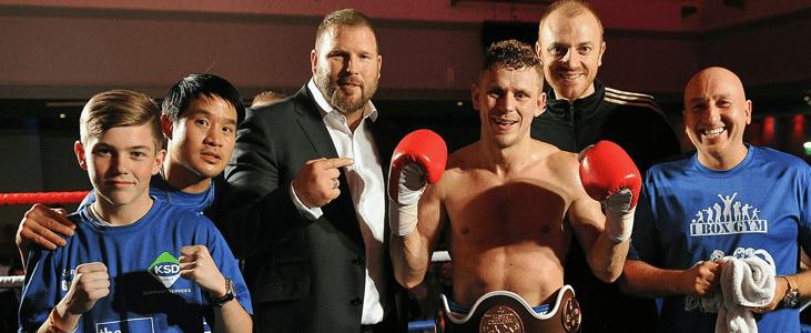 Lloyd-Ellett-Masters-belt-with-team
