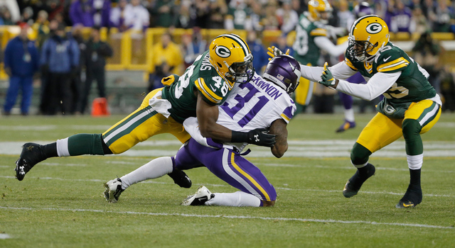 GREEN BAY, WI - JANUARY 03: Joe Thomas #48 of the Green Bay Packers tackles Jerick McKinnon #31 of the Minnesota Vikings during the first quarter of their game at Lambeau Field on January 3, 2016 in Green Bay, Wisconsin. (Photo by Jon Durr/Getty Images)