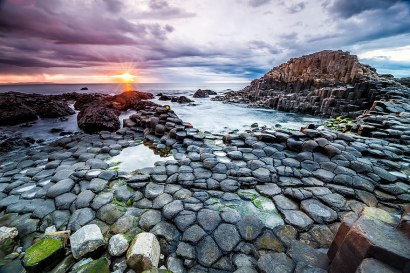 Giants Causeway Beach, Ireland. The giant's causeway was formed 50-60 million years ago when basalt lava rose to the surface and cooled, cracking into strange, large columns.Image credits: Stefan Klopp
