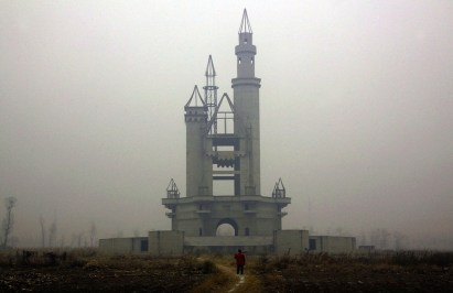 Wonderland Amusement Park - Beijing, China. Designed to be the biggest amusement park in Asia, Wonderland was never completed after financial issues. The land has since been cultivated by local farmers.
