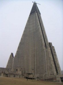 Ryugyong Hotel - Pyongyang, North Korea. The Ryugyong Hotel is a true display of North Korea's madness. Work started on this 105 story hotel only a few years before a massive famine plagued the country. Abandoned for 16 years, work once again began in 2008, when it was coated in $150 million worth of glass. Foreign guests have reported that although the structure now looks complete on the outside, a lot of the interior is still abandoned and incomplete.