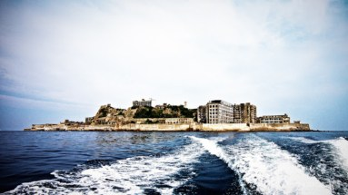 Hashima Island, Japan. In the past Hashima Island was rich in coal, with over 5000 miners once living on the island. When petrol replaced coal as Japan's main source of fuel, the settlement was left abandoned. Now the once thriving town is creepily abandoned, with only shadows remaining.