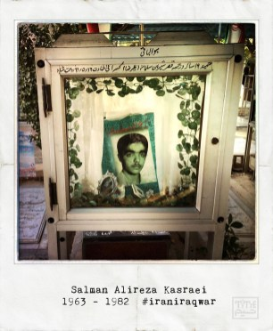 A picture taken with an iPhone on September 19, 2014 and processed with Hipstamatic and Polamatic applications shows a portrait of Salman (Alireza) Kasraei inside a decorative box next to his grave at martyrs section of Behesht Zahra (Zahra's Paradise) cemetery, south of Tehran. Kasraei was a 19 year old Iranian member of Revolutionary Guards, killed on August 7,1982 in Qasr-e Shirin city of Kermanshah province during the Iran-Iraq war (1980-88). The war between Iran and Iraq was the longest conventional war of 20th century and was officially started on September 22, 1980, when Iraqi armed forces invaded western Iran and ended on August 20, 1988, when Iran accepted the United Nation's ceasefire resolution 598. More than one million people died in the eight-year war