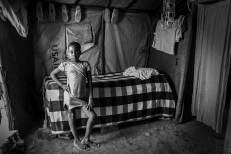 Almate, 10, has been living in Camp Mozayik since 2012 (first evacuation). She is currently living with her father who is often away in the city to find work. Photo by Bahare Khodabandeh, Jan 11 2015, Haiti.
